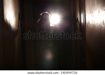 Silhouette of the woman dancing with backlight - stock photo