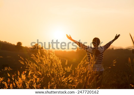Silhouette of the women raise hand - stock photo