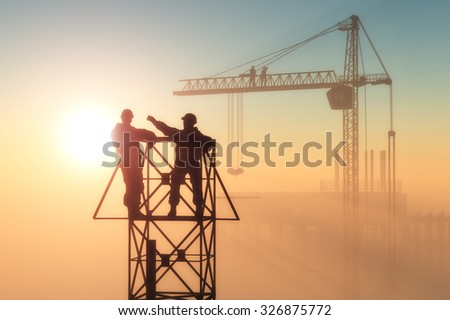 Silhouette of the worker on the rig. - stock photo