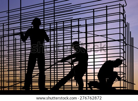 Silhouette of the workers on a background of the sky