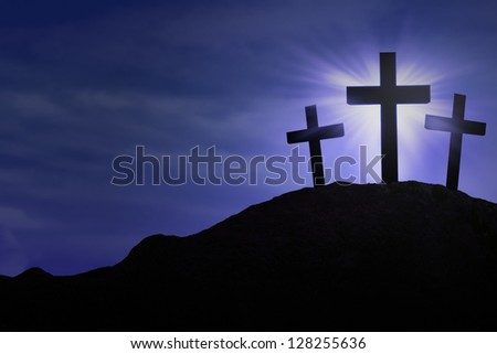 Silhouette of three crosses on blue background - stock photo