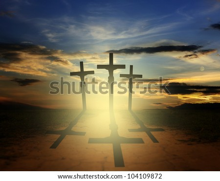 Silhouette of three easter crosses on the road - stock photo