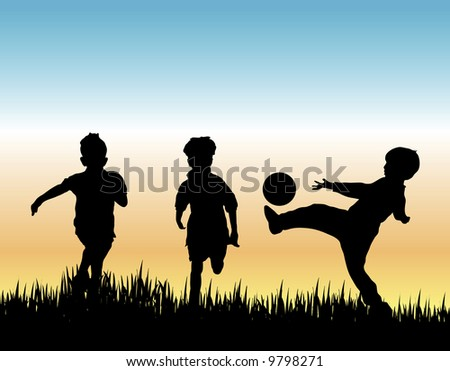silhouette of three young boys playing soccer - stock photo