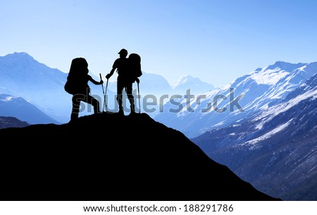 Silhouette of tourists in mountains. Sport and active life concept - stock photo