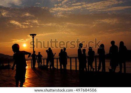 Silhouette of tourists looking with sunset. Chiangkhan Thailand