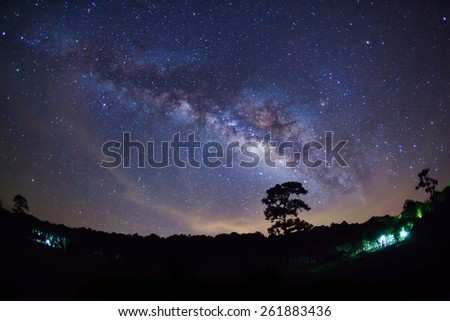 Silhouette of Tree with cloud and Milky Way. Long exposure photograph. - stock photo