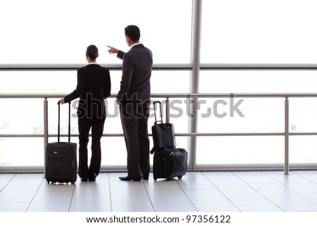 silhouette of two businesspeople at airport - stock photo