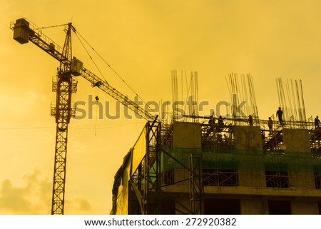 Silhouette of under construction building at twilight - stock photo