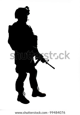Silhouette of US soldier with rifle - stock photo