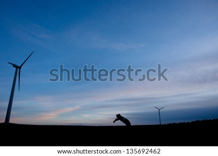 silhouette of wind power mills - stock photo