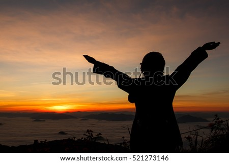 silhouette of woman gesturing success  over morning sky-2