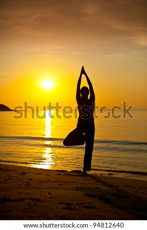 Silhouette of woman in yoga