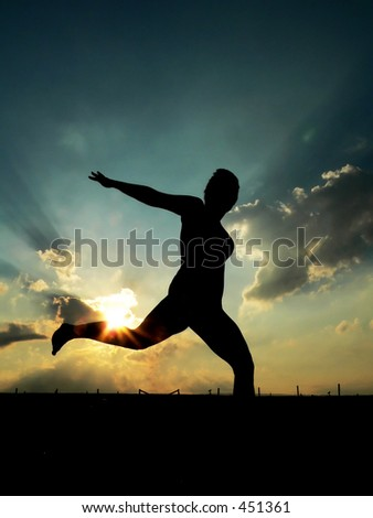 Silhouette of Woman Jumping - stock photo