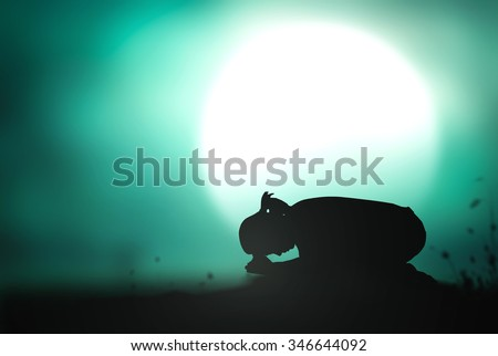 Silhouette of woman kneeling and praying over beautiful full moon light background. Christmas Worship Forgiveness Mercy Humble Evangelical Hallelujah Thankful Praise Redeemer Amen Good Friday concept - stock photo