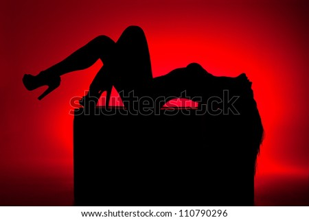 silhouette of woman on red background