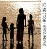 Silhouette of woman with children on sea beach - stock photo