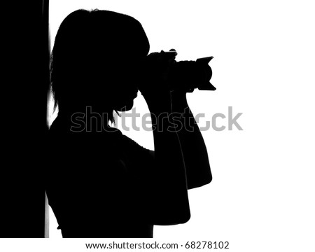 Silhouette of woman with photo camera isolated on white - stock photo