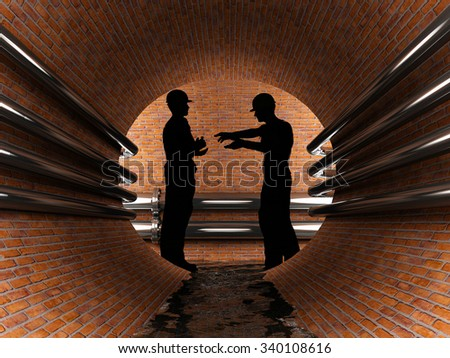 Silhouette of workers in the tunnel. - stock photo