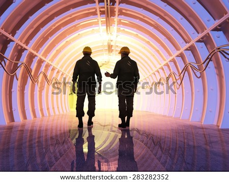 Silhouette of workers in the tunnels. - stock photo