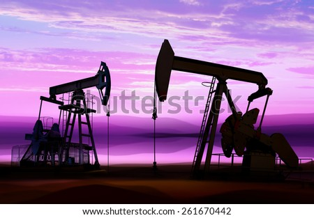 silhouette of working oil pumps on cloud sky - stock photo