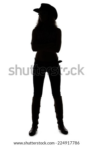 Silhouette of young cowgirl on white background - full length - stock photo