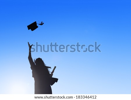 Silhouette Of Young Female Student Celebrating Graduation - stock photo