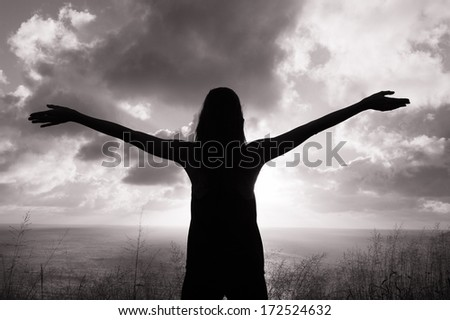 Silhouette of young girl outdoor. Freedom concept. - stock photo