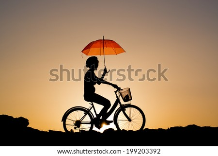 Silhouette of girl with umbrella stock photos illustrations and