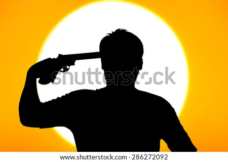 silhouette of Young man commits suicide with his gun  - stock photo