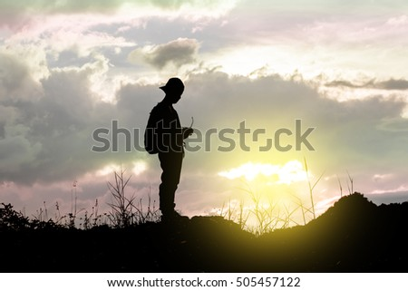 Silhouette of young man standing looking his 