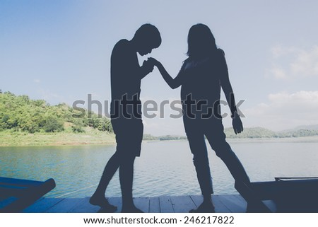 Silhouette of Young Romantic Couple,valentine's day - stock photo