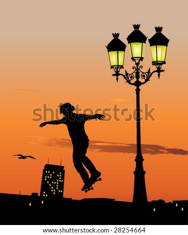 Silhouette of young skateboarder jumping in late evening