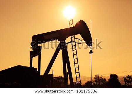 Silhouette Oil Pump Jack (Sucker Rod Beam)  - stock photo