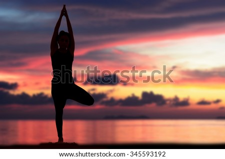 Silhouette one woman with professional yoga posture on the beach at sunset. - stock photo