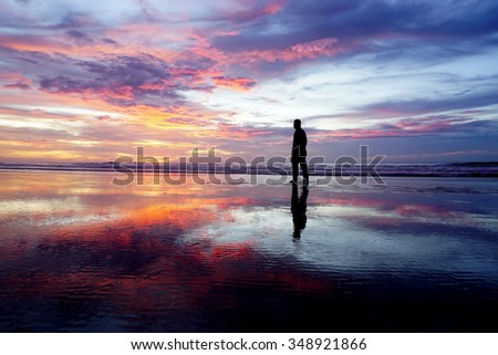 silhouette people on great sunset and water reflection. - stock photo