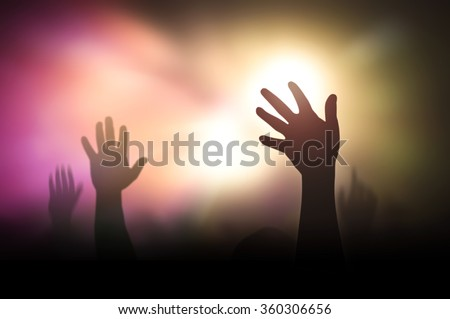 Silhouette people raising hand on blurred colorful light background. Worship, Forgiveness, Mercy, Humble, Evangelical, Hallelujah, Thankful, Praise, Redeemer, Amen, Human Rights Day, Humanity concept - stock photo