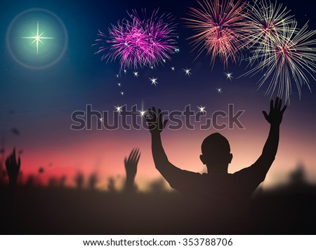 Silhouette people raising hands over beautiful fireworks on night background. Merry Christmas Card Happy New Year 2016 2017 Mercy Humble Hallelujah Thankful Redeemer Amen Pray Hope Hosanna concept. - stock photo