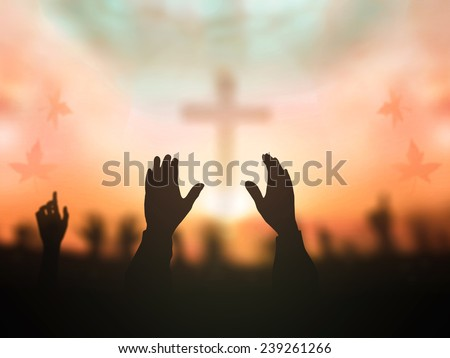 Silhouette people raising hands over blurred crown of thorn and the cross on autumn sunset background. Worship, Forgiveness, Mercy, Reconcile, Adoration, Glorify, Redeemer, Redemption, Praise concept. - stock photo
