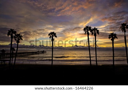 silhouette Pier with Beautiful Sunset Sky in San Clemente - stock photo