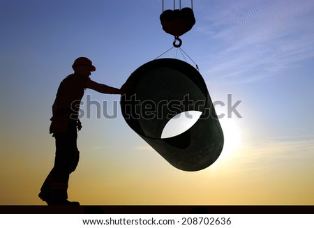 Silhouette pipe and builder. - stock photo