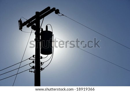 Silhouette Power lines back lit by the afternoon sun - stock photo