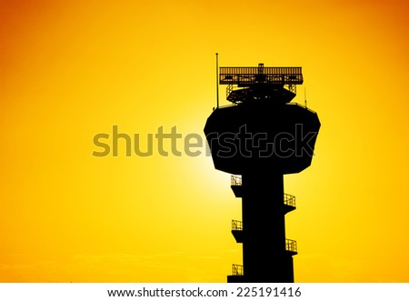 Silhouette radar communication tower in evening. - stock photo