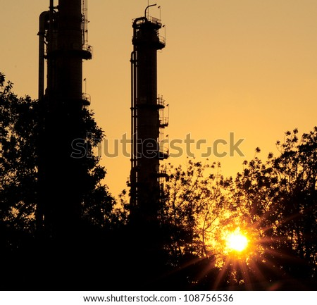 silhouette refinery Column in sun set Theme - stock photo