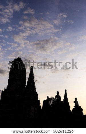 Silhouette ruins temple with evening sky in Ayuttaya, Thailand.