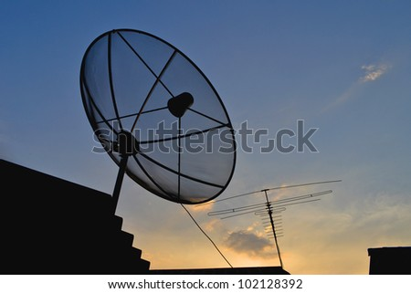 silhouette Satellite Dish and Antenna TV on Sunset Time