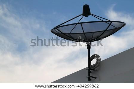 Silhouette Satellite dish on sky background - stock photo