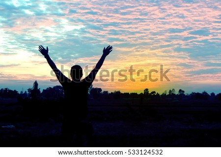 silhouette sky man hands up standing evening twilight