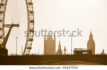 Silhouette Skyline of the London Eye, Big Ben, Westminster and London bus. - stock photo