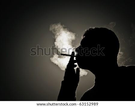 Silhouette smoker - stock photo