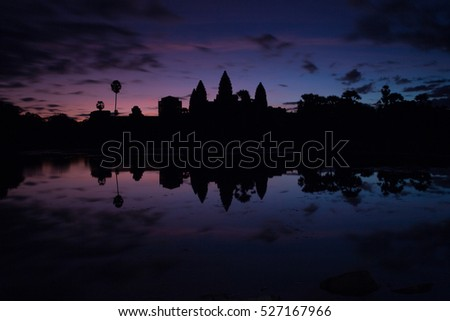Silhouette Sunrise at Angkor Wat Siem Reap, Cambodia. Temple Mountain and the sun reflected in lake at dawn. Mysterious Angkor Wat is a popular tourist attraction.